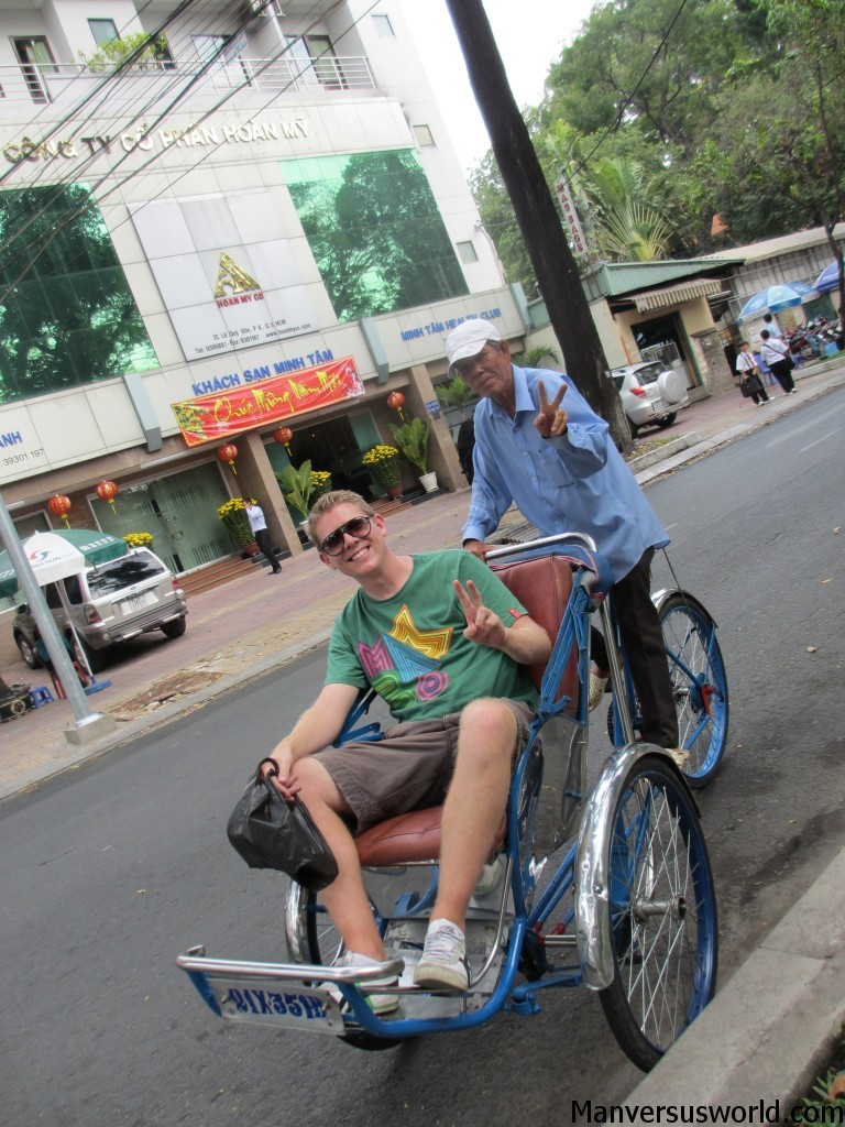 Catching a cyclo in Ho Chi Minh City, Vietnam.