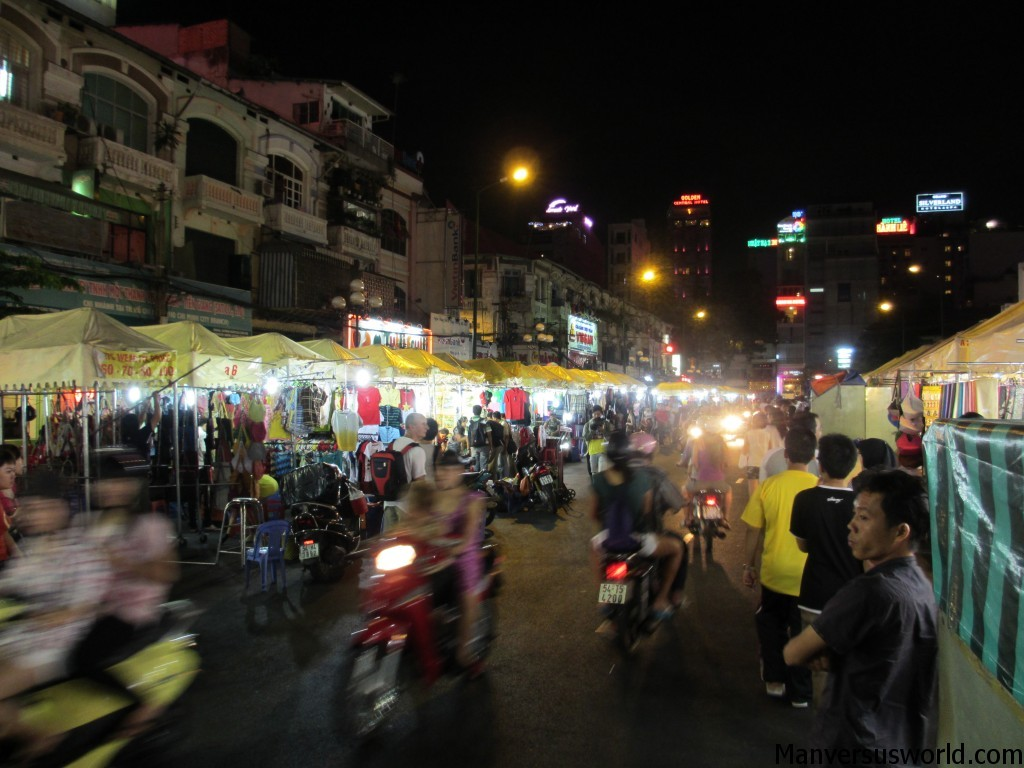 Night market in Ho Chi Minh in Vietnam, with scooters rushing past.