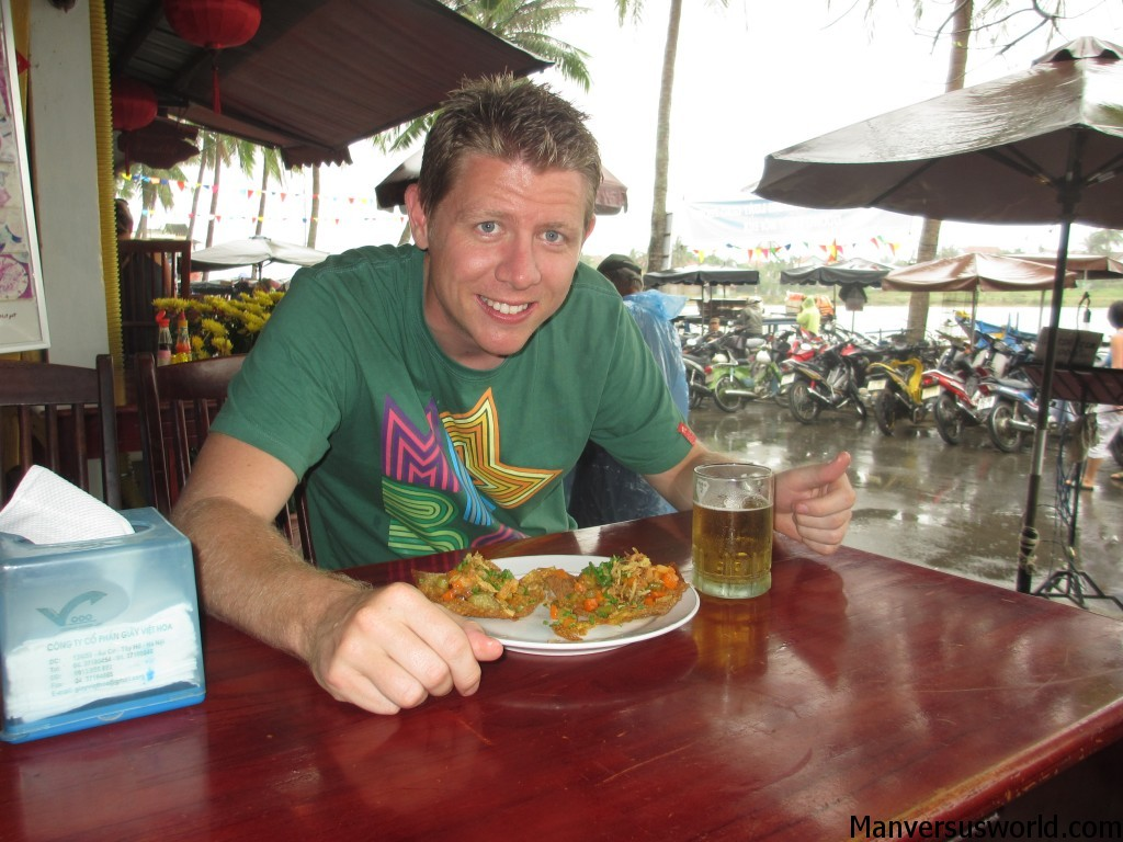 Me eating a plate of local wontons in Hoi An, Vietnam.