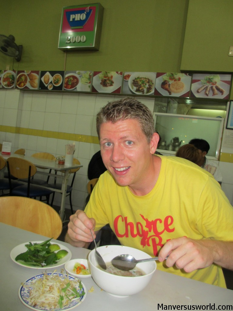 Tucking in to a large bowl of pho at Pho 2000 in Vietnam.
