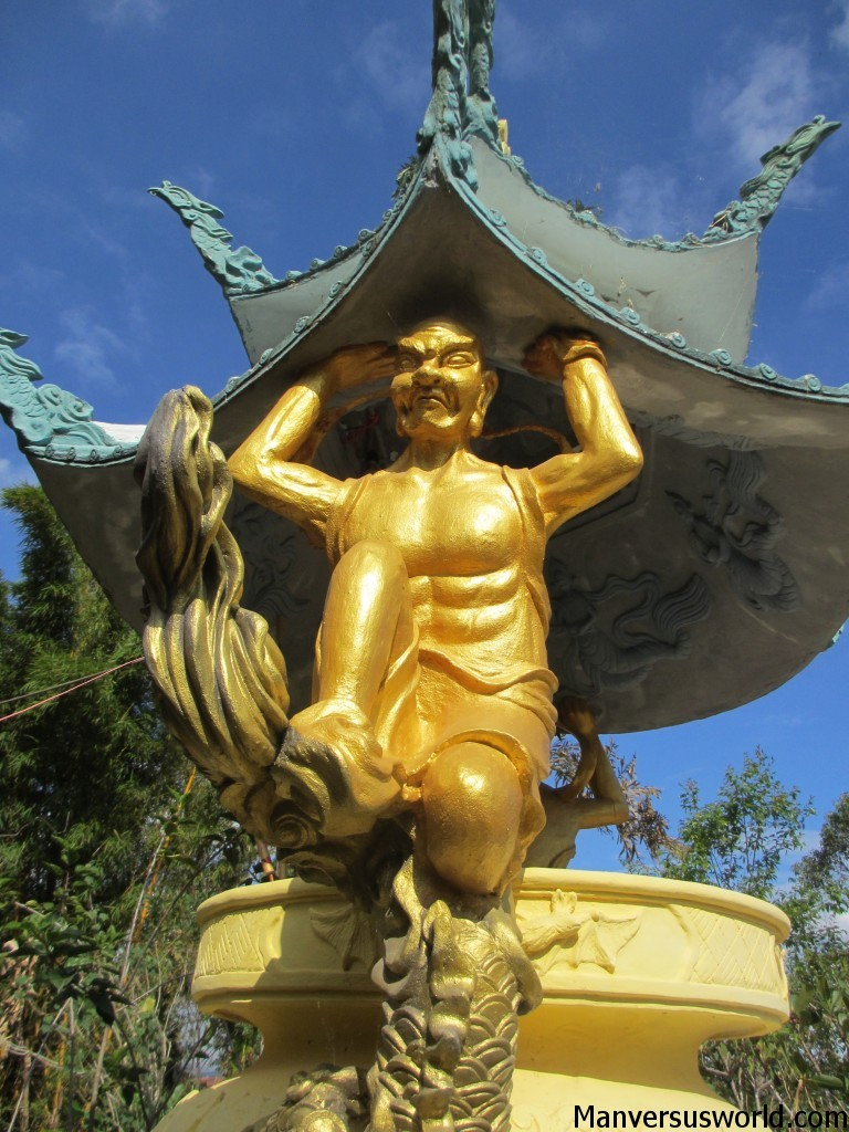 A gold statue at a temple in Dalat, Vietnam