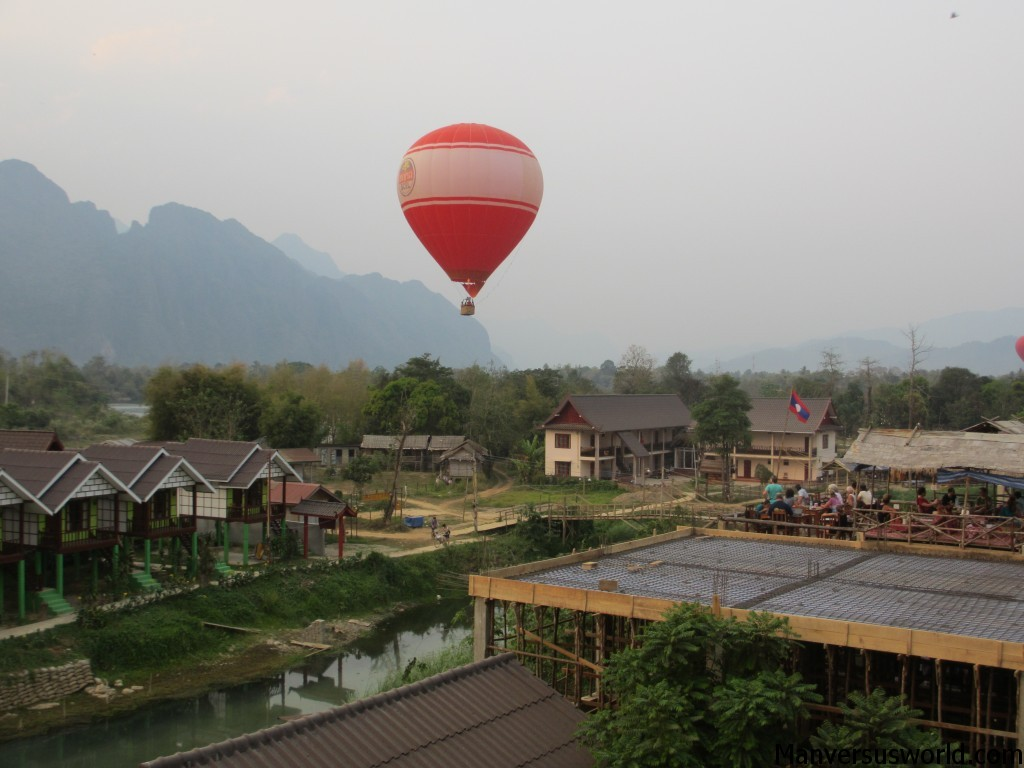 A hot-air balloon floats above Vang Vieng, Laos
