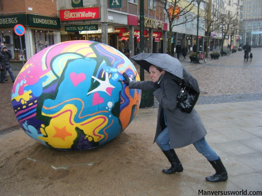 Nicola tries to push a giant Easter egg in Sweden