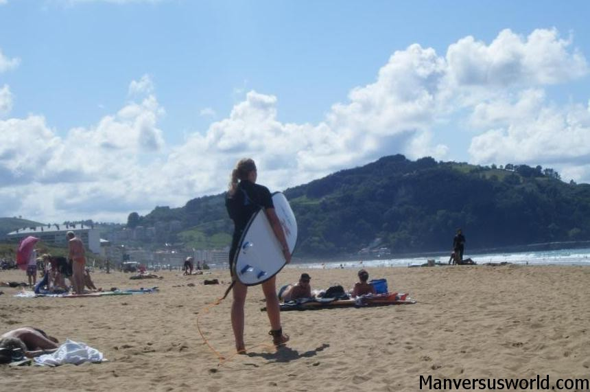 A surfer on the beach in San Sebastian