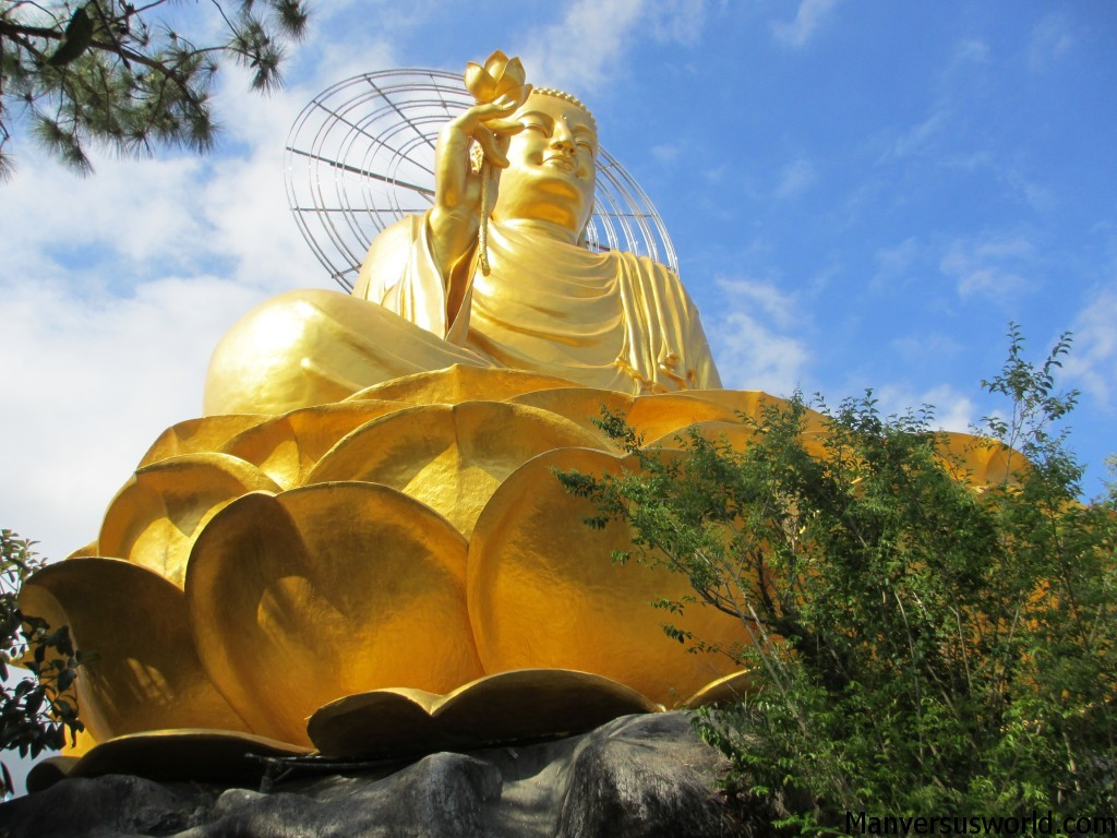 A golden budha sits atop of one of Dalat's many hills
