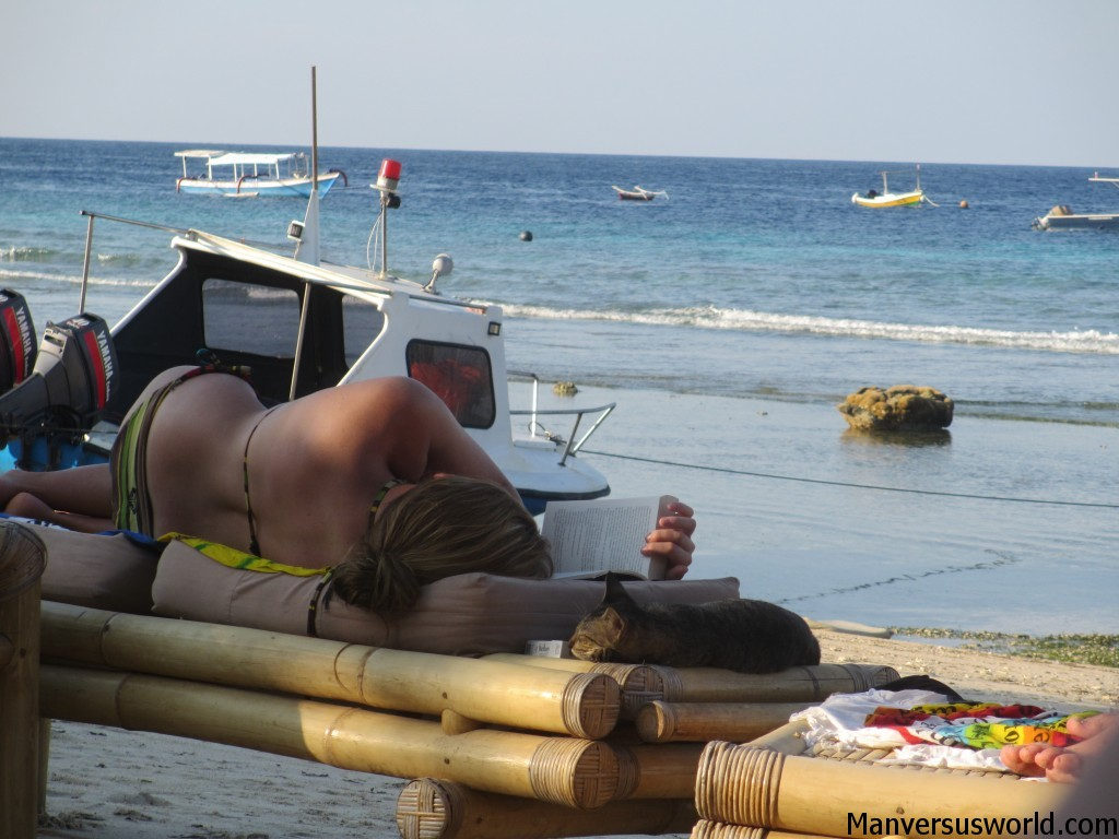 A cat sleeps on a beach chair in Gili Trawangan