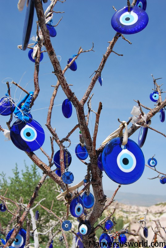 Nazar beads hang from a tree in Turkey