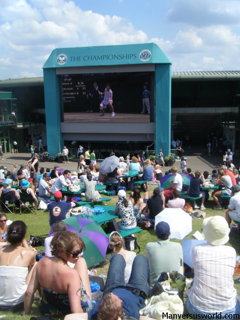 The crowd gathers at Henman Hill for Wimbledon tennis action