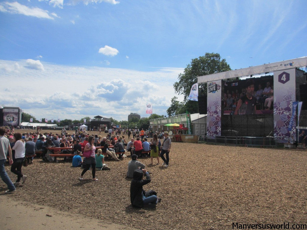 People sit on the ground at London Live in Hyde Park