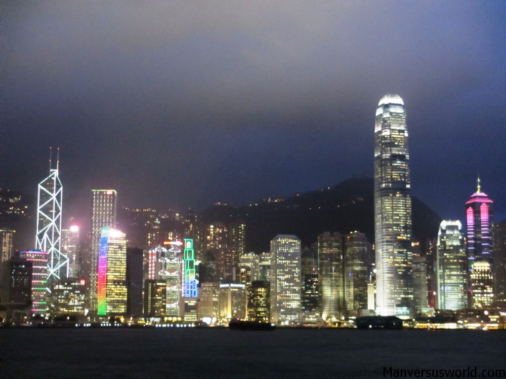 Hong Kong's city skyline at night and by boat