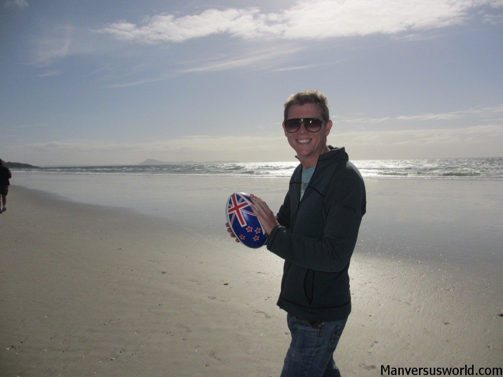 Me and a New Zealand rugby ball on the beach