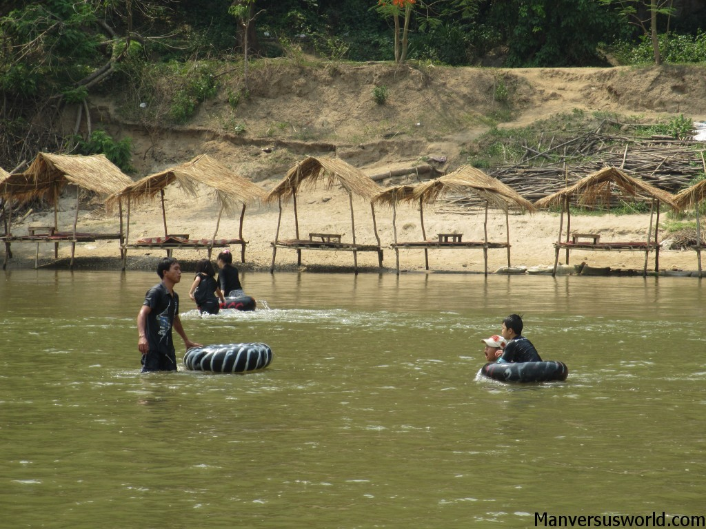 Children tubing at Chiang Rai beach, Thailand