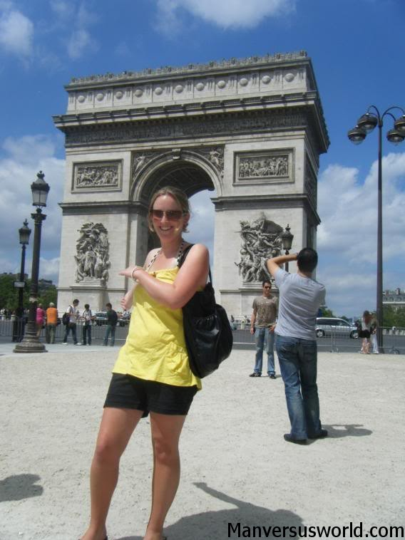 Nic stands in front of the Arc de Triomphe in Paris
