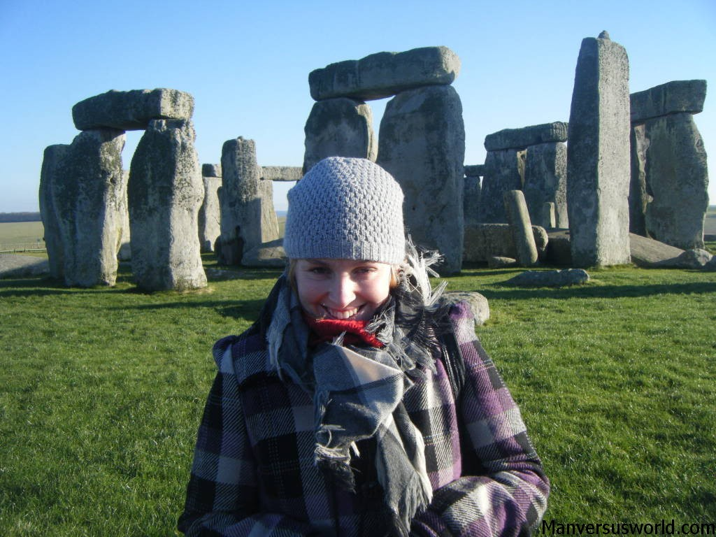 A cold and wintery day at Stonehenge - my fiance Nic in a purple jacket