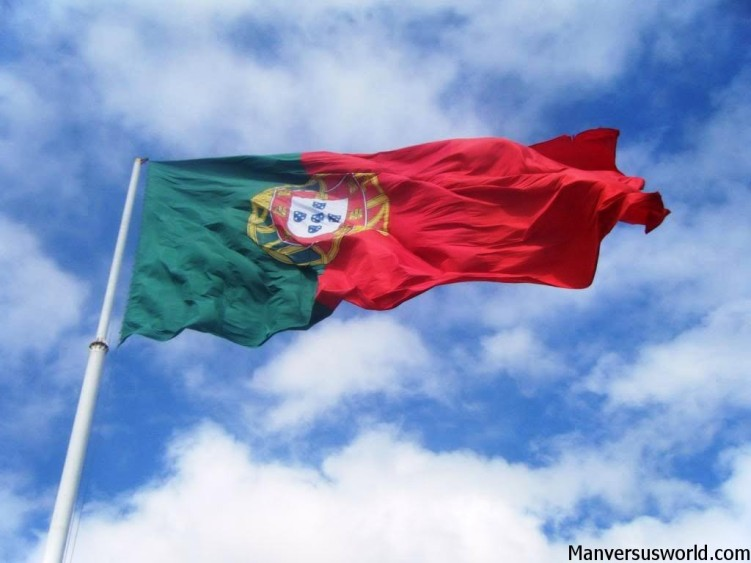 The flag of Portugal flies high above Lisbon