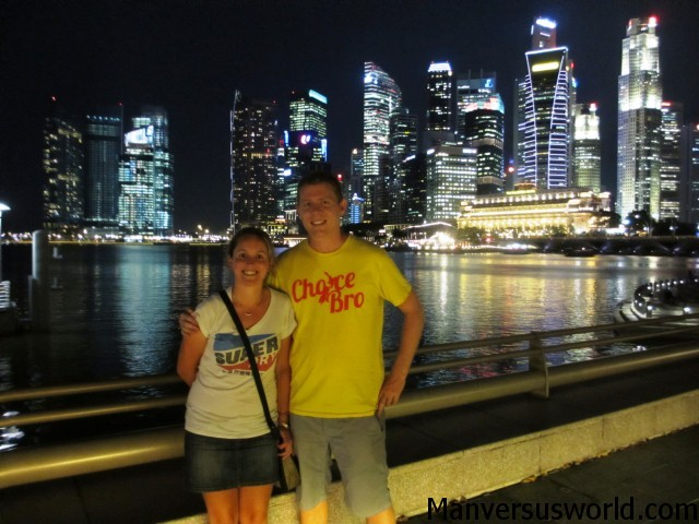 Me and Nic in front of the Singapore skyline at night