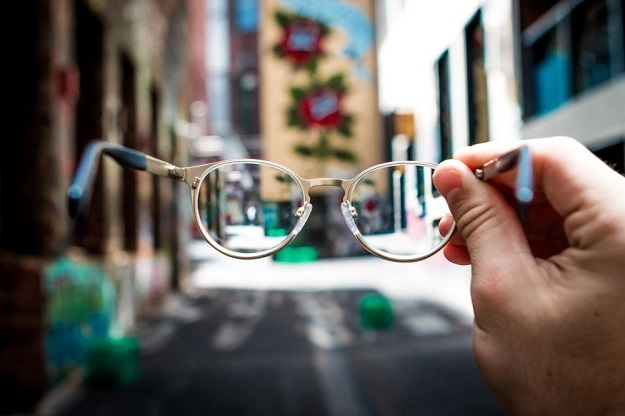 Hand holding glasses in the street