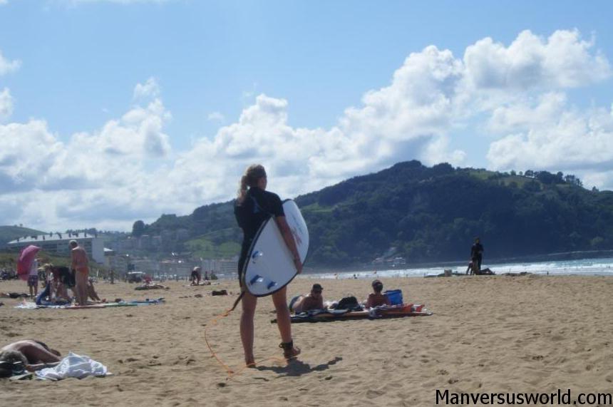 A surfer on the beach in San Sebastian