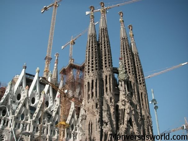 Cranes tower above the La Sagrada Familia Basilica in Barcelona, Spain
