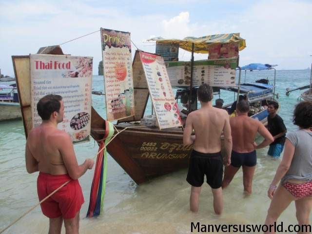 A food boat on Railay Beach in Thailand