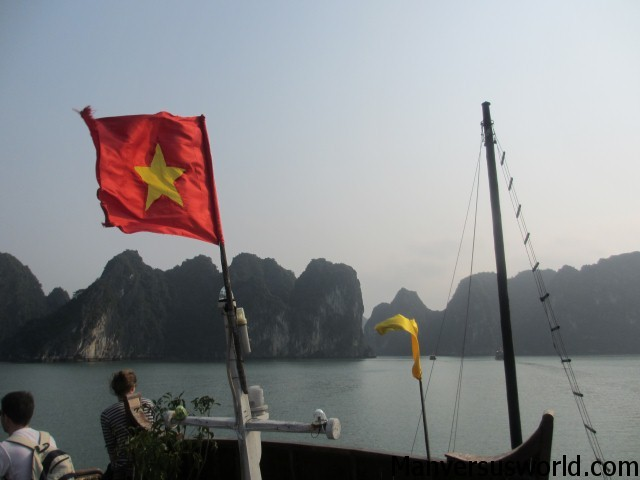 The Vietnamese flag flies on Halong Bay